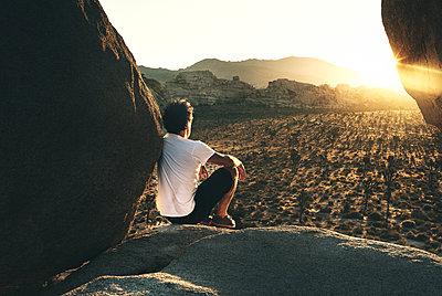 Man and sunrise in Joshua Tree Ca. - p1166m2152136 by Cavan Images