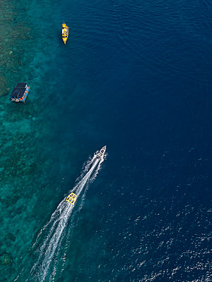 Towable water tube is being pulled by a speedboat - p1108m2090348 by trubavin