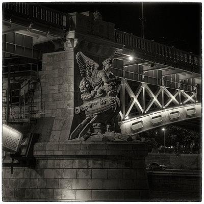 Bridge with winged statue - p1154m1193275 by Tom Hogan