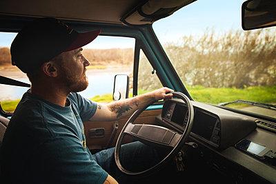 Man driving car - p1166m1037565f by Cavan Images