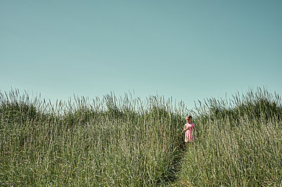 Little girl on serene green field  in Iceland - p1166m2130742 by Cavan Images