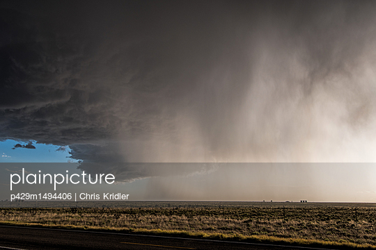 Supercell thunderstorm drops large hailstones over New Mexico desert landscape, USA