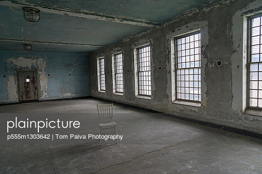 Chair in empty warehouse - p555m1303642 by Tom Paiva Photography