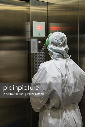 Asia, Thailand, Bangkok, COVID-19, Person in protective suit - p728m2206026 by Peter Nitsch