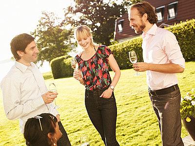 Friends having champagne - p31224114f by Jonas Ingerstedt