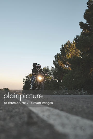 couple riding a motorcycle on the road - p1166m2207817 by Cavan Images
