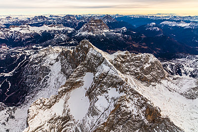 Aerial view of snow covered Monte Civetta, Ampezzo Dolomites, Italy - p1166m2104683 by Cavan Images