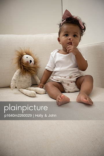 Multi ethnic toddler girl with cuddly toy - p1640m2260029 by Holly & John