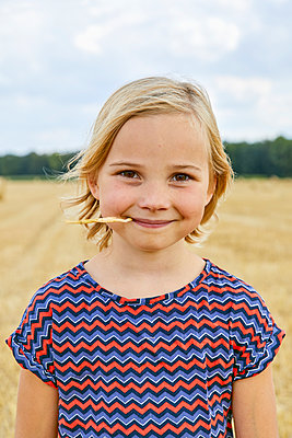 portrait of a girl in a wheat field - p1540m2200507 by Marie Tercafs