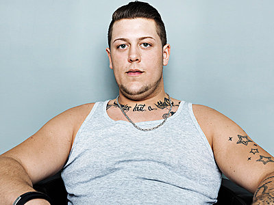Portrait of young man with tattoo;  close up - p300m837021f by Stefan Kranefeld