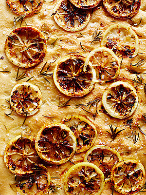 Still life close up of Italian lemon foccacia - p429m1013072f by BRETT STEVENS