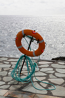 A life preserver on a pier - p30117622f by Marc Volk