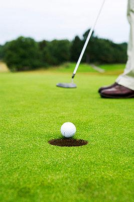 A man playing golf Sweden. - p31218403f by Plattform