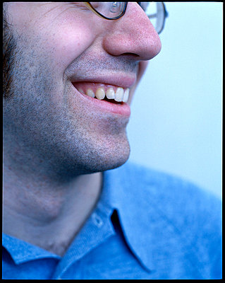 Cropped image of man's smiling face - p3720298 by James Godman
