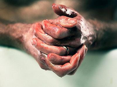 Fishmonger washing bloodied hands - p92411699 by Inigo Kraber