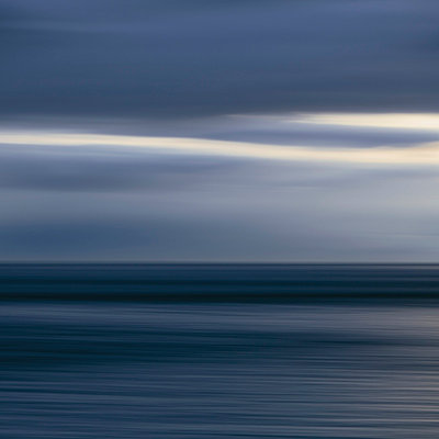 The sea and sky over Puget Sound in Washington, USA. The horizon with light cloud layers above. Gathering storm clouds. - p1100m875574 by Paul Edmondson