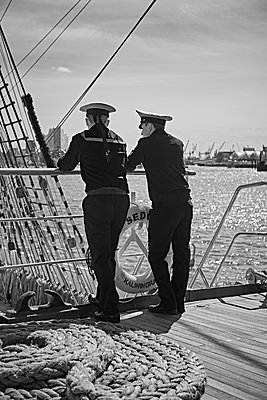 Germany, Hamburg, Two sailors on the railing - p1198m2278304 by Guenther Schwering