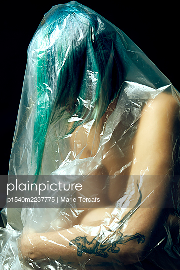 Naked woman wrapped in plastic tarpaulin - p1540m2237775 by Marie Tercafs
