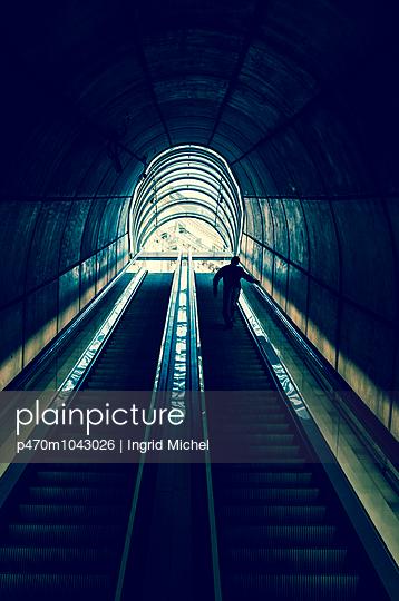 Man on an escalator - p470m1043026 by Ingrid Michel