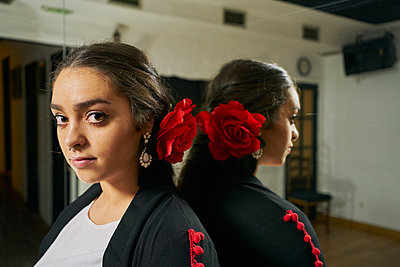 Young Woman Dancing Flamenco On Black - p1166m2179622 by Cavan Images