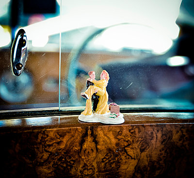 Wedding Couple Figurine in back seat of a Limo - p1072m874930 by Neville Mountford-Hoare