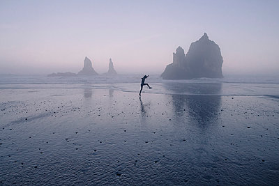 Woman Skipping Along Ocean Shore - p1262m1064012 by Maryanne Gobble