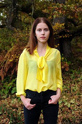 Teenage girl in yellow blouse - p1412m2128857 by Svetlana Shemeleva
