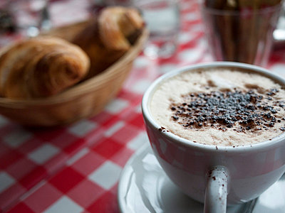 Close-up of cappuccino and croissant - p388m702005 by Andre