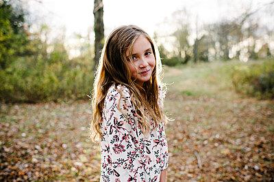 Portrait of confident girl standing at park - p1166m1555648 by Cavan Images