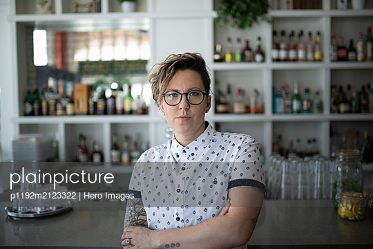 Portrait of small business owner in cafe looking at camera - p1192m2123322 by Hero Images