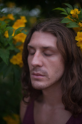 Man in flowers - p1517m2065250 by Nikita Pirogov