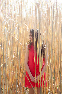 Woman among the reeds I - p402m901386 by Ramesh Amruth