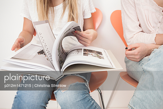 Girl with book on her lap - p312m1471215 by Christina Strehlow