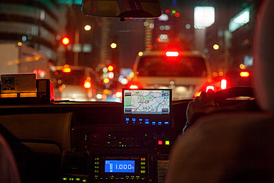 GPS navigational system on dashboard of taxi - p1166m1141482 by Cavan Images