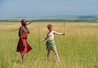 Safari guide, Salaash Ole Morompi, guiding young boys on a family safari (MR) - p6521193 by John Warburton-Lee