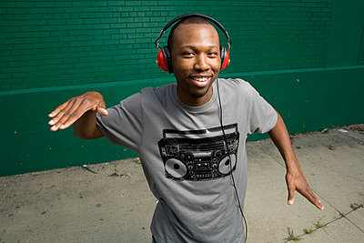 African-American man wearing headphones, dancing - p3722668 by James Godman
