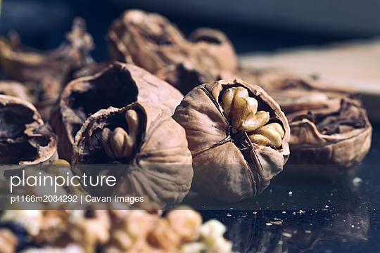 Still Life of Broken Nuts Prepared to Eat - p1166m2084292 by Cavan Images