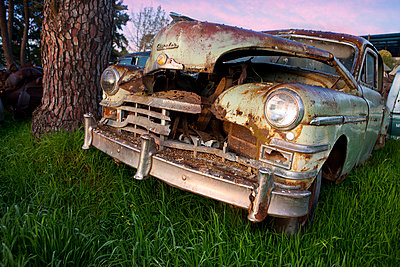 Close up of vintage car in scrap yard - p429m875754f by Zero Creatives