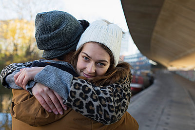 Portrait happy young woman hugging boyfriend - p1023m2161735 by Tom Merton