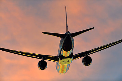 Boeing 777 airliner flying - p1048m2035801 by Mark Wagner