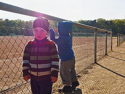 Two children at fooball ground - p358m1138302 by Frank Muckenheim