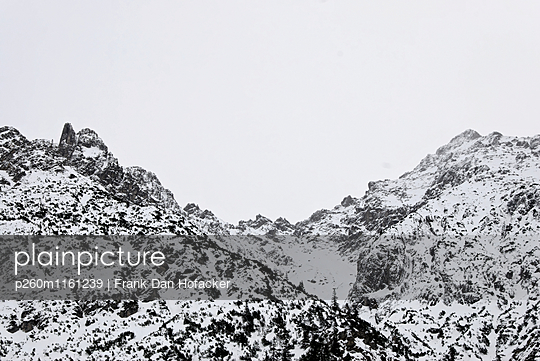 Snow-covered mountain range - p260m1161239 by Frank Dan Hofacker