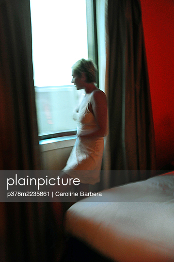 Woman in hotel room - p378m2235861 by Caroline Barbera