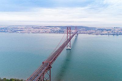 Aerial view of suspension bridge of 25th of April, Ponte 25 de Abril - p1332m2197115 by Tamboly