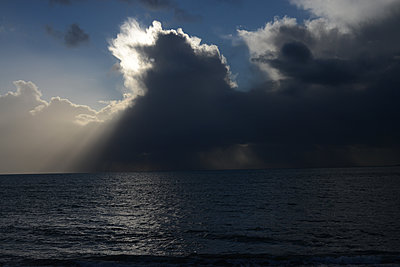 Clouds and ocean - p1631m2230937 by Raphaël Lorand