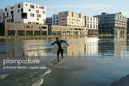 SURFING IN THE CANAL DE L OURCQ - p1610m2186030 by myriam tirler