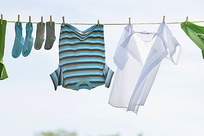 Laundry Hanging On Outdoor Clothesline; Toronto Ontario Canada - p442m839458 by Bruno Crescia