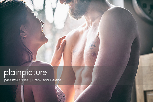 Semi-naked hipster couple bonding at home - p429m2091129 by Frank and Helena