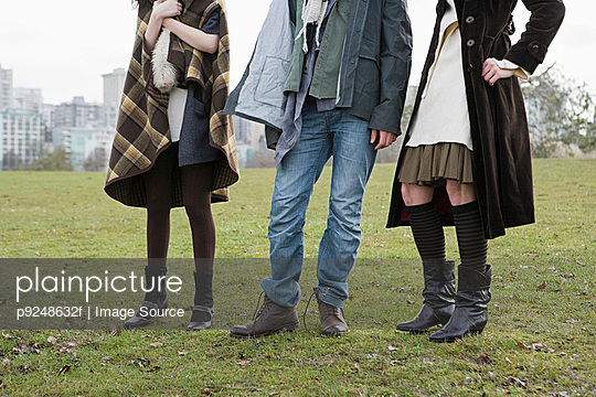 People standing in field - p9248632f by Image Source