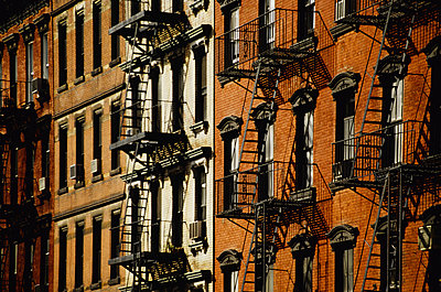 New York brick buildings with fire-escapes - p1418m1559099 by Jan Håkan Dahlström